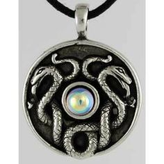 """Depicting two tangled serpents, coiled around a small clear crystal upon a circular disc, this amulet is called simply Nathair, the Celtic word for snake.  This makes it a powerful token of wisdom and guile, with the snake frequently being revered as a creature that embodies these qualities. Wear it to help focus your thoughts when you are in need of patience and in this find greater wisdom to guide your actions. This amulet, made of pewter, measures approximately 1 1/4"""" in diameter. $7.95"""