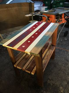 Table I made for my shop. Used pallet wood and some cull lumber I got. Later added casters