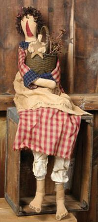 "Annabelle Primitive Doll With Basket & Angel - Annabelle is a very sweet antique looking primitive doll. She is a large 48"" tall doll and is wearing a burgundy check homespun dress with blue plaid cuffs and collar. At the top of her dress there are rusty tin bells."