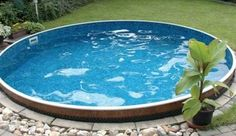 above ground pool with landscaping... I SOOO HAVE THE BACKYARD FOR THIS!