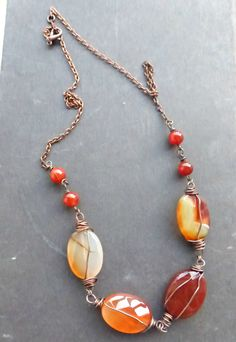 creamsicle. Orange carnelian stone, copper wire wrapping, necklace, bracelet and earrings set.