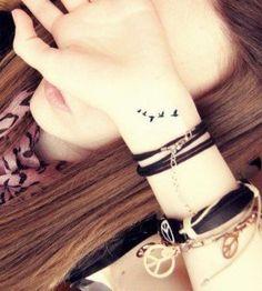 Woman wrist bird tattoo