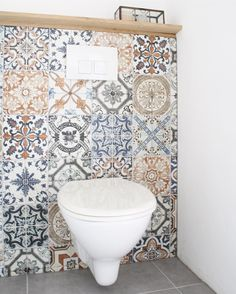 I love the idea of random mosaic tiles as a backsplash in a bathroom nook.
