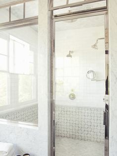 Interesting - a shower room ...    Tim Barber - Stunning shower with mosaic tiles shower surround and rain shower head.