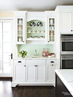 Cabinet idea for over the fridge.  Except make it a wine cabinet