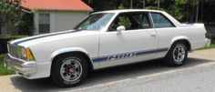 1980 Chevrolet Malibu M80. 1 of 1,901 built; 4-barrel, 305 CI V8 engine & automatic transmission; white exterior w/ blue stripes & blue vinyl interior.