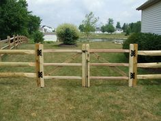 Split Rail Wood Fence w/ Gate. Love the style of this fence, not sure it would go with our house, but still love it.