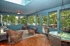 What a bright screened porch, definitely need to brighten the front porch by painting the wood.