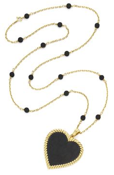Van Cleef & Arpels. An Ebony Wood and Gold Pendant Necklace,  Suspending From a Gold Link Chain, with Ebony Wood Accents, c. 1975. By Van Cleef & Arpels. Available at FD.  www.fd-inspired.com