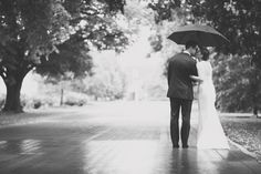 bride and groom, black and white, umbrella