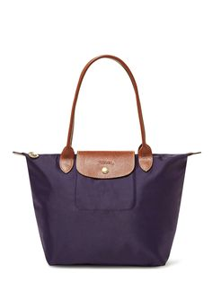 """Longchamp Le Pliage Nylon Tote  Foldable nylon tote with long handles    Nylon and leather   Two handles   Zip top with leather flap and snap closure   One slip pocket inside     Measurements:   Body length: 10½"""", height 9½"""", width 5½""""; handle drop 8""""   This product was sourced for Gilt by a trusted independent supplier.    Material:  Textile and leather   Brand:  Longchamp   Origin:  Imported"""