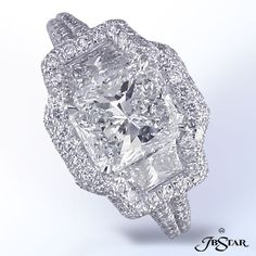 Three stone engagement ring - radiant cut center stone with brilliant cut trapezes in a pave halo with a double pave shank (dreamy)