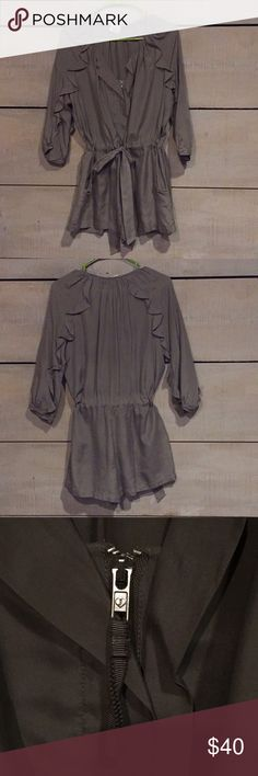 French Press 100% silk Juicy Romper Gorgeous silk romper by Juicy. Freshly dry cleaned. Pockets. Tag removed but I added a pic of the hardware to show Juicy. Juicy Couture Other