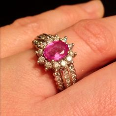 """Stunning pink sapphire/ diamond cocktail ring 7.5 This large pink sapphire is surrounded by diamonds and set in a wide white gold band with triple rows of diamonds. This is absolutely fabulous.  One of the final pieces of my """"ex"""" collection that I'm parting with.  I do not have the appraisal (the ex kept that) so I am selling at a very low price. If you are a serious buyer I am willing to get an appraisal but I will increase the price according to the appraisal. This is not costume jewelry…"""
