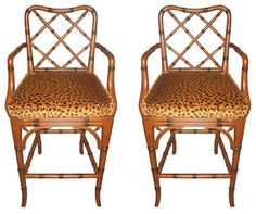 Pair of Faux Bamboo Stools With Faux Leopard Cushions eclectic bar stools