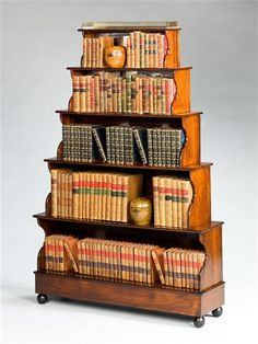 A PAIR OF WILLIAM IV ROSEWOOD ETAGERES, England, circa 1840 | London | Mallett Antiques A highly unusual pair of William IV stepped etagere with each tier having scrolling sides and the upper two enriched with mirrored backs. The whole surmounted by a pierced brass gallery.