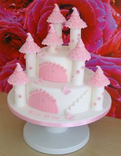 Fairytale Castle -  Vanilla sponge with jam & buttercream ..covered in white fondant. The turrets are pastillage and the rest of the decorations are fondant, then covered in lots of edible glitter.