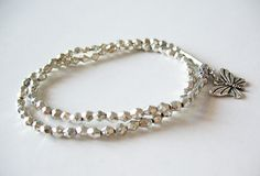 stacked silver bracelet with butterfly charm