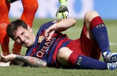 Lionel Messi suffered a knee injury early in Saturday's La Liga game at home to Las Palmas and w...