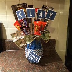 Graduation Gift Bouquet For A Guy Filled With His Fav Candy Some Fishing Stuff A Giftcard Some Money