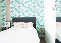""""""" I love my palm tree wallpaper. I was terrified of committing to real wallpaper, but I am so glad I got over my fear."""" The wallpaper is Fanned Fronds from Anthropologie. The best is Restoration Hardware's Printmaker's Storage bed."""