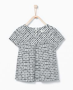 This pleated top from Zara is for girls who like a dressier look, but may not enjoy pink and ruffles. The black and white check print is simple and the pleat adds a nice touch. Sizes 3-12.
