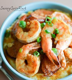 CAJUN SHRIMP AND GRITS |  Creamy cheesy grits piled high with sausage and juicy shrimp and a Cajun sauce. @savoryspicerack