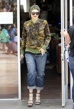 Gwen Stefani in boyfriend jeans and camo.