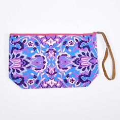 Carry all the essentials in boho chic style with the exotic awesomeness of the Calliope Kaleidoscope pouch.  This unique clutch purse is crafted from vibrant cotton canvas, lined with bright nylon, and features a sophisticated leather wristlet strap to make carrying it a breeze!