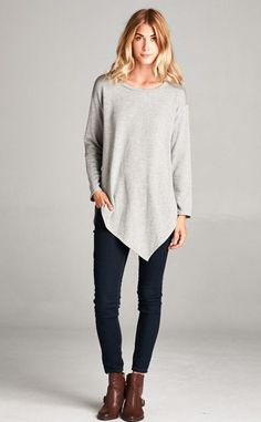 This asymmetrical sweatshirt is a fun take on a comfy classic. It's thick, warm and fuzzy on the inside, and has the perfect amount of stretch. Pair it with jeans or your yoga pants and nikes. *Due to