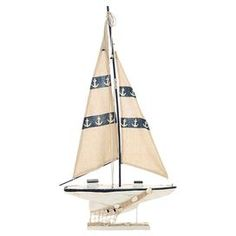 "Weathered wood sailboat decor with anchor-print sails.  Product: Sailboat décorConstruction Material: Wood, rope and canvasColor: White and blueFeatures: Perfect for any shelf or tabletopDimensions: 33"" H x 17"" W x 2"" D"