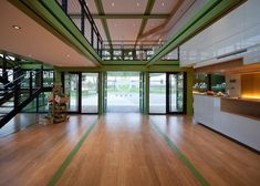 What a great interior design for a container home! The green is amazing! My favorite color!