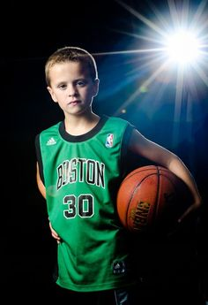 A new look for kid's basketball pictures. Under the bright lights. This image links to a tutorial on how to create these pictures.