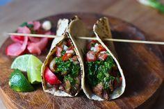 Scrumptious grilled steak tacos with cilantro chimichurri sauce!