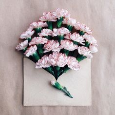 Kiev-based photographer Anna Remarchuk has created these poetic compositions tucking flowers inside of envelopes from her great-grandfather. White with red picotee carnations.