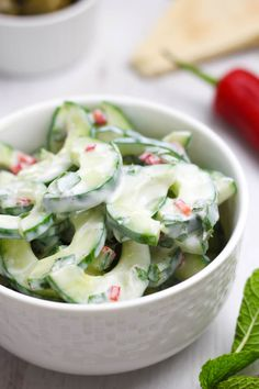 Spicy yogurt cucumber salad - this is so light and fresh, and makes a great alternative to lettuce-based salads. Serve it with olives and pitta bread for a yummy Greek-style mezze!