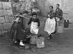 Seoul families without running water in their homes carried it in buckets from a public tap. November 1945