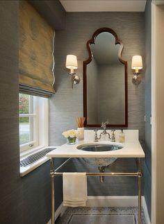 Lavish powder room with grasscloth wallpaper, roman shade, Art Nouveau mirror, + Herbeau Royale faucet. Amy Miller Interior Design.