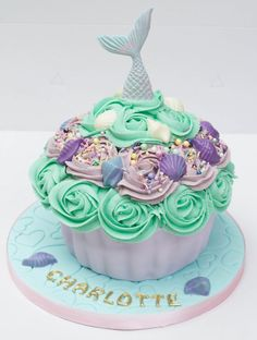 Mermaid themed giant cupcake with chocolate shells Large Cupcake Cakes, Mermaid Cupcake Cake, Little Mermaid Cupcakes, Big Cupcake, Mermaid Cakes, Giant Cupcakes, 10th Birthday Cakes For Girls, Mermaid Birthday Cakes, 1st Birthday Cake Smash