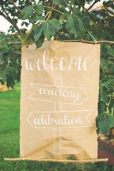 calligraphy wedding sign, photo by The Nickersons http://ruffledblog.com/north-arm-farm-wedding #signage #weddingsigns #kraftpaper