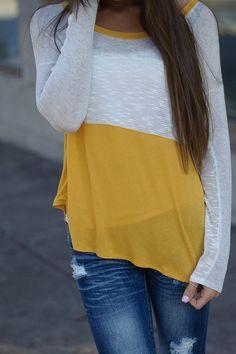 Colorblock round neck lightweight knit top. Mustard