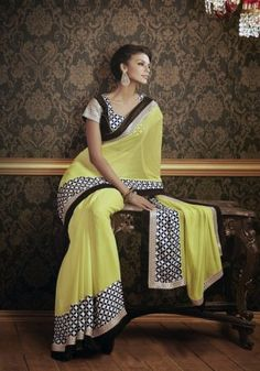 Fancy Yellow And Black Georgette Saree