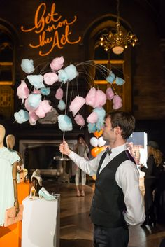 In late February, fashion retailer Ted Baker hosted a private event in New York to preview its Spring/Summer 2014 line. Inspired by the circus theme of the collection's ad campaign, caterer Creative Edge Parties served carnival finger foods in a playful, mess-free way. That included staffers circulating with what they called a cotton candy tree—cotton candy clipped to a willow-tree-shaped metal frame that guests could easily pull off with their hands.