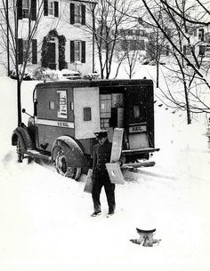 1949. City carrier delivering packages in the snow. The carrier's vehicle was designated to carry parcels only, not letter mail.
