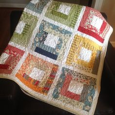 Wee play log cabin quilt by christy murray, via Flickr