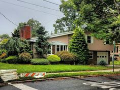 A #house and #shrubbery in #Concord, #Staten_Island.