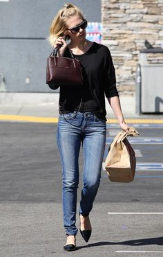 January Jones Carries a Little Version of Coach's Big New Bag - Page 3 of 5 - PurseBlog