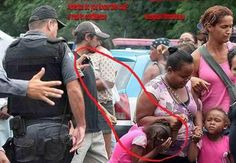 cop pepper sprays child! Look at the last on the far left pointing his evil ass out. She's my hero.