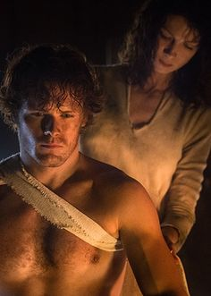 A little shirtless Jamie action! Sam Heughan as Jamie Fraser and Caitriona Balfe as Claire Randall in Outlander on Starz