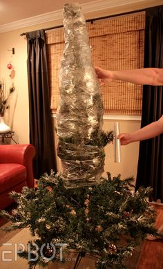 Oh How FUN.  This is one way to keep bugs out of it!  How To Shrink-Wrap Your Christmas Tree.
